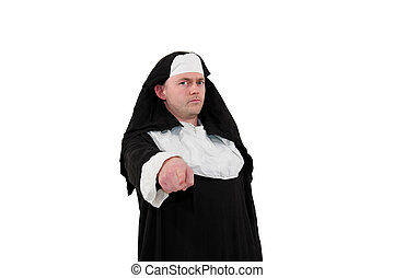 male actor in a nun´s costume pointing with finger