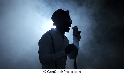 Male african american musician in the smoke and white light...