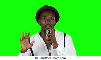 Male african american musician singing in a recording...