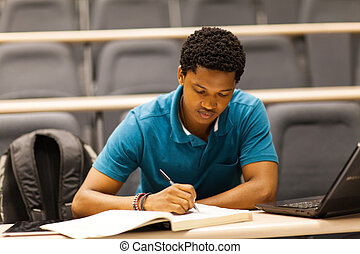 male african college student in lecture room