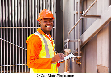 male african electrical worker in front of transformer