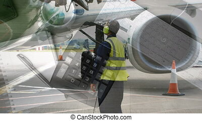 Male airport worker working against calculator, coffee cup ...