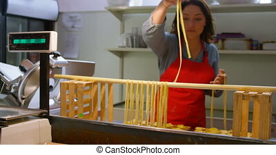 Male and female baker preparing pasta 4k - Male and female ...