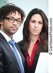 Male and female business duo