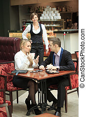 male and female colleagues in a cafe.