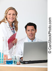 Male and female colleagues in laboratory