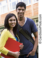 Male and female college students on campus