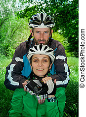 male and female cyclists in nature