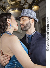 Male And Female Dancers Performing Tango In Cafe