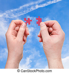male and female hands with little puzzle pieces - male and ...
