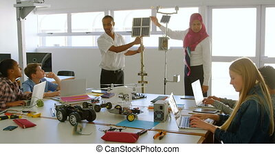 Male and female pilot training about solar panel to kids 4k...