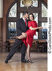Male And Female Sensuous Partners Performing High Leg Wrap