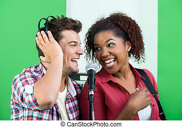 Male And Female Singers Performing While Looking At Each Other