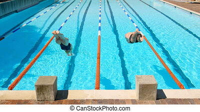 Male and female swimmer preparing to dive in pool 4k