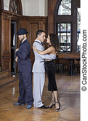 Male And Female Tango Dancers Performing In Restaurant
