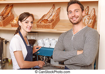 Male and female workers in cafe