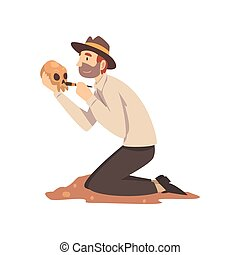 Male Archaeologist Sweeping Dirt from Human Skull, Scientist...