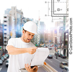 male architect looking at blueprint
