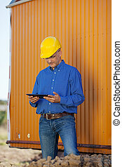 Male Architect With Digital Tablet