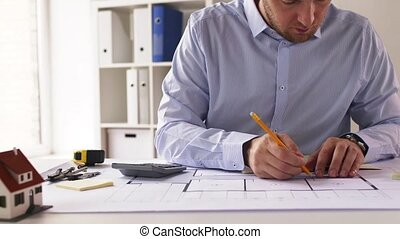 male architect with ruler measuring blueprint -...