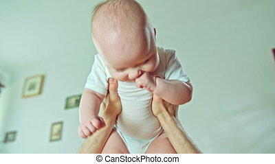 Male Arms Holding a Baby