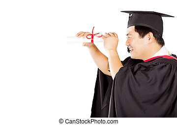 male asian graduate looking through diploma isolated on white