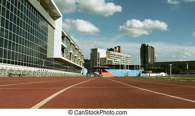 male athlete disability on carbon fiber prosthetic running...
