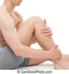 Male Athlete Holding Leg isolated on white