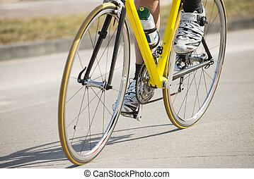 Male Athlete Riding Bicycle - Low section of male athlete...