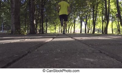 Male athlete running in the Park.