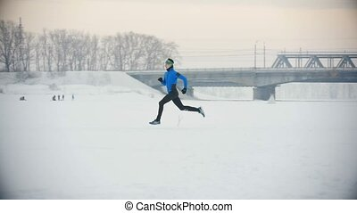 Male athlete running in winter outdoor