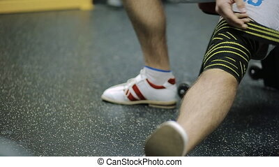 male athletes aged rewinds his knee on the leg hair sport...
