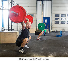 Male Athletes in Cross Fitness Box - Two male atheletes...