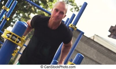 Male Athletic Man Working Out In Summer Day