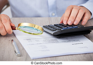 Male Auditor Scrutinizing Financial Documents - Midsection ...