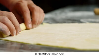Male baker rolling dough in bakery shop 4k - Close-up of ...