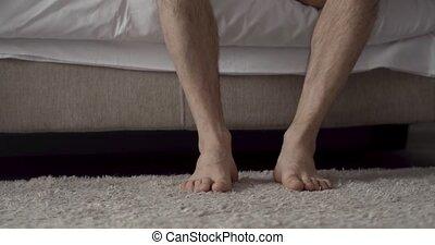 male bare feet photo - Close up portrait of man s feet on...