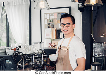 Male Barista cafe owner holding coffee cup in store counter bar inside coffee shop, food and drink business start up