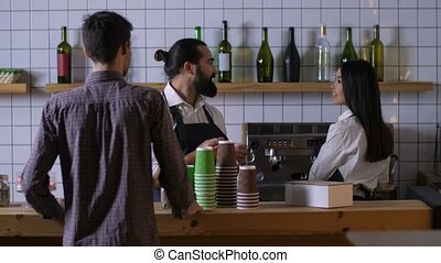 Male barista communicating with client at cafe - Positive...