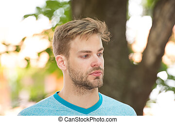 Male beauty. Sport wellbeing and self care. Handsome man sporty outfit look confident. Guy handsome bearded face. Sportsman lifestyle. Metrosexual appearance concept. Handsome athlete in park