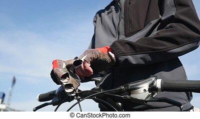Male biker wearing sport gloves