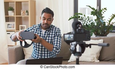 male blogger with vr glasses videoblogging at home -...
