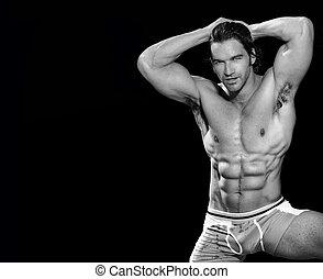 Male bodybuilder - Black and white fine art portrait of a...