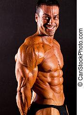 male bodybuilder flexing muscle