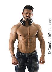 Male bodybuilder listening to music on white