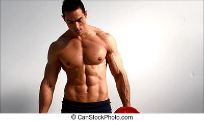 Male bodybuilder training obliques - Young male bodybuilder...