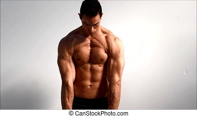Male bodybuilder training shoulders