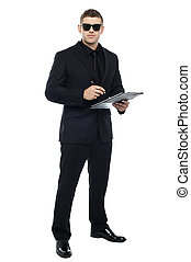 Male bouncer holding clipboard