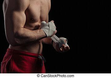 Male boxer preparing for fight