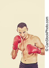 male boxer ready to fight with boxing gloves